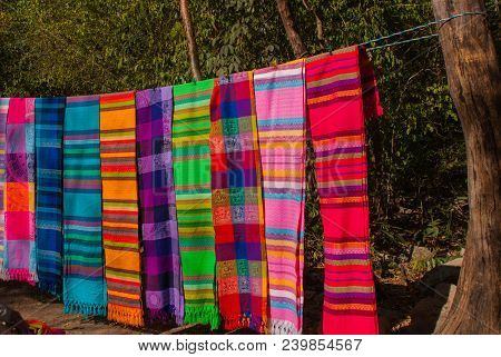 Souvenirs On The Market. Multi-colored Clothes. National Clothes Of Mexico. Multicolored Textiles Be