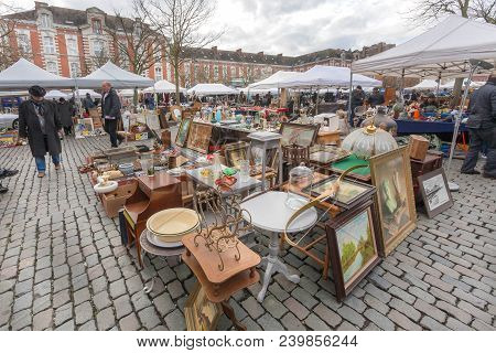 Brussels, Belgium - Apr 3: Customers Of Flea Market Looking For Art, Bargains And Antique Stuff In M