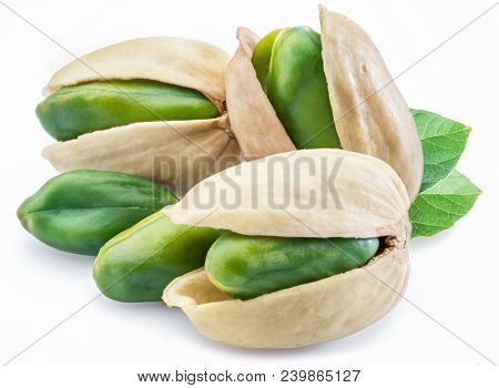 Green pistachio nuts with pistachio shell on white background.