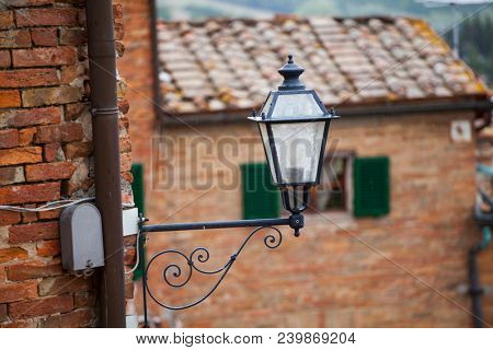 Old styled lamp in small italian village in Tuscany