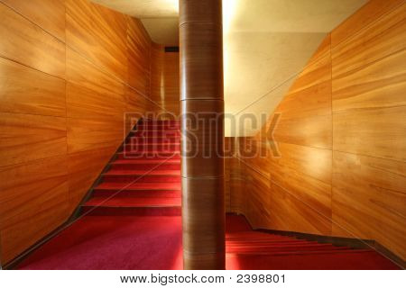 Modern Stairway, Wood Wall And Red Velvet Carpet