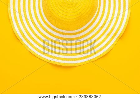 Top View Of Yellow Hat. Striped Hat Over Yellow Background. Retro Yellow Hat. Close-up Of Yellow Hat