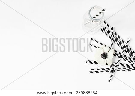 Breakfast Or Birthday Party Desktop Scene. Composition With Empty Milk Glass Jar, Black And White Dr