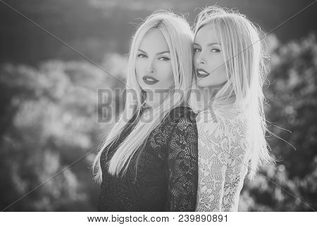 Two Women With Red Lips And Long Blond Hair. Dualism And Dualistic Nature. Contrasts And Opposites C