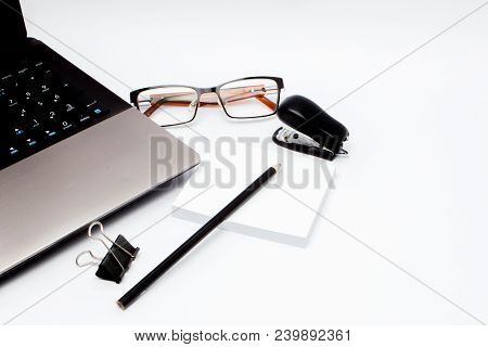 Stationary Concept, Flat Lay Top View Photo Of Laptop, Pencil, Stapled, Paper Clips, Eyepieces, Note