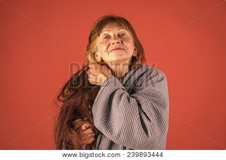 Old Lady With Hair Brush On Red Background. Hairdresser And Barbershop. Haircare And Beauty. Senior