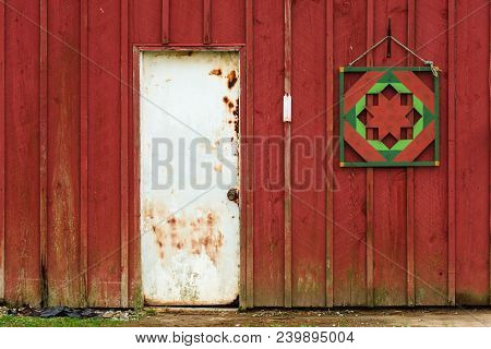 Pennsylvania Barn Entrance. Rustic And Distressed Red Barn And Closed White Door, Faded Thermometer,