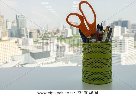 Tools And Office Stationary In Green Metal Pencil Box On Office Desk