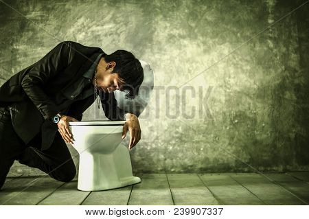 Young Man With Vomiting Due To Drinking. He Is Not Healthy