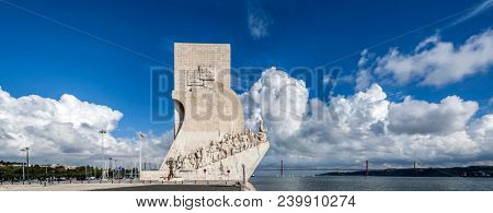 Lisbon, Portugal - June 30, 2013: Padrao dos Descobrimentos monument and Tagus River. The Sea Discoveries Monument commemorates the Portuguese navigators who explored the oceans and continents