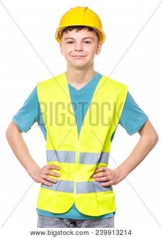 Emotional Portrait Of Teen Boy Wearing Safety Jacket And Hard Hat. Happy Child Looking At Camera, Is