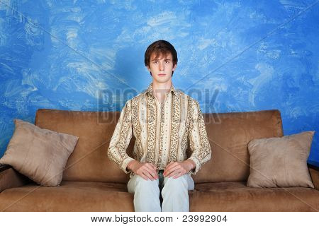 Stiff Young Man On Sofa