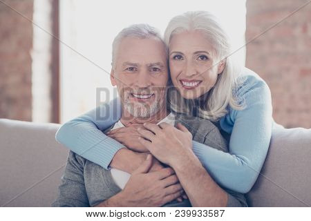 Close Up Portrait Of Two Happy Old Married People, They Are Hugging And Have Perfect Shiny White Smi