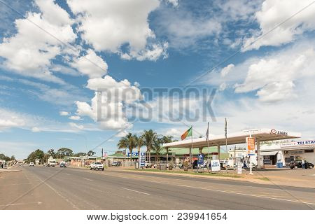 Dundee, South Africa - March 21, 2018: A Street Scene With A Gas Station And Vehicles In Dundee In T