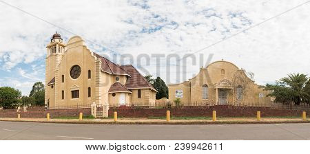 Dundee, South Africa - March 21, 2018: A Street Scene, With The Dutch Reformed Church And Hall, In D