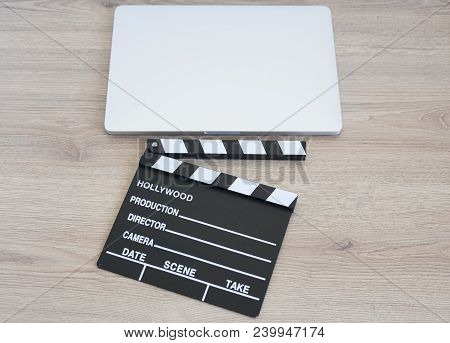 Movie Clapper And Laptop On The Wood Table