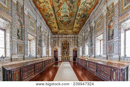 Lisbon, Portugal - September 9, 2013: Baroque Sacristy of the Mosteiro de Sao Vicente de Fora Monastery with pink, white and black marble inlay designs on walls. Alfama District