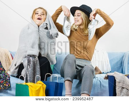 Two Happy Joyful Women Having Fun After Shopping, Picking Outfit In Closet. Female Friends Fooling A