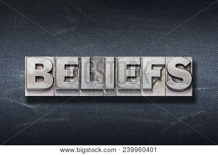 Beliefs Word Made From Metallic Letterpress On Dark Jeans Background