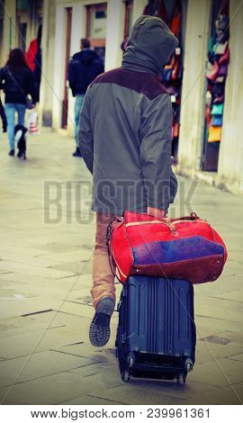 Vagabond With Suitcase Luggage Trolley In Calle Of Venice  With Vintage Effect
