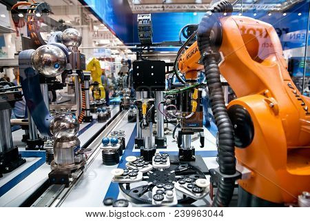 Hannover, Germany - April, 2018: Schunk Assembly Electronics Line With Robots On Messe Fair In Hanno
