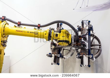 Hannover, Germany - April, 2018: Automatic Industrial Robot Fanuc R-2000ib Concept Auto Service Work
