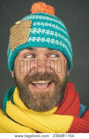 Smiling Handsome Bearded Man, Sexy Guy In Knitted Hat And Scarf. Winter Fashion. Brutal Caucasian Hi