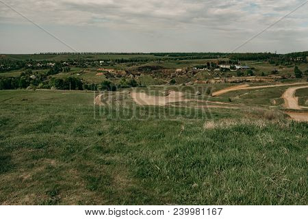 Off Road Motocross And Auto Sport Track On Blue Sky And Clouds Background. A Country Road. Outdoor M