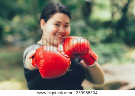 Big Asian Woman Boxing Fighter With Fat And Diet Concept