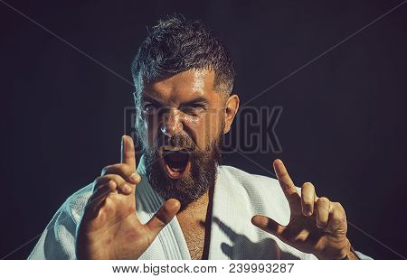 Karate Man In Action. Strong, Angry, Bearded Man Dressed In Kimono, Shaking Fist, Portrait Screaming