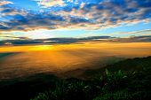 Fantastic dreamy sunrise on top of mountain. Mountain view. Dreamy forrest. Sunrise clouds poster