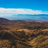 Beautiful overlook of San Bernardino Mountains and Coachella Valley from Joshua Tree's highest viewpoint, Keys View, Joshua Tree National Park, Riverside County, California poster