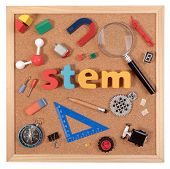 STEM Education. Science Technology Engineering Mathematics. STEM word on cork board with education equipments for background. poster