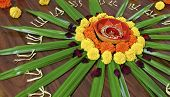 Rangoli floral design display Hindu Festival by womenfolk a custom done outdoors or indoors during celebrations like Diwali and Holi landscape horizontal with crop margin poster