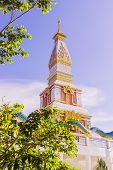 Thai Buddhist pagoda at Doi Thepnimit temple on Patong hilltop. It is the newest landmark for tourists of Phuket, Thailand. It has been built in style of Pra Tat Pra Nom at Northeast of Thailand. poster