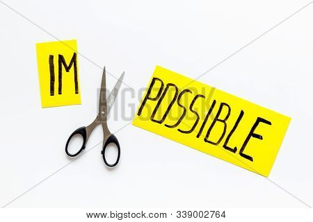 All Is Possible Concept. Cut Word Impossible Near Scissors On White Background