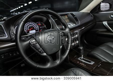 Novosibirsk, Russia - October 23, 2019:  Nissan Teana, Dashboard, Player, Steering Wheel With Logo A