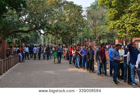 Agra, India - Nov 12, 2017. Local People Stand In Line To Get Inside Taj Mahal In Agra, India. Over