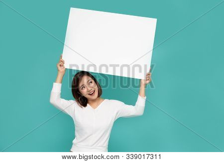 Young Attractive Asian Woman Showing And Holding Blank White Board, Showing Empty Board For Input Yo