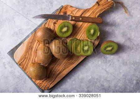 Kiwi Slice And Whole Kiwi Fruit. Fresh And Juicy Kiwi Fruit And A Half On Cutting Board.  Sweet And