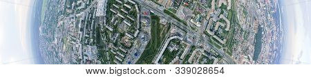 Aerial Panorama Banner View Of The City With Traffic, Streets And Buildings With Green Trees And Rai