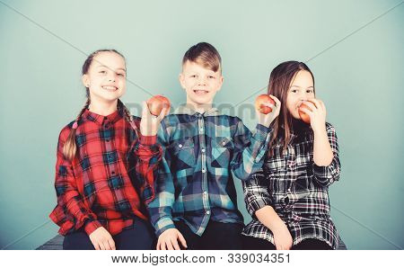 Having Tasty Snack. School Snack Time. Boy And Girls Friends Eat Apple Snack. Teens With Healthy Sna