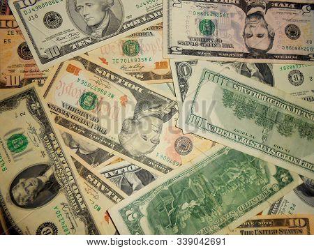 Dollar Bill Cash Money Low Salary Pansion Taxes Background. Screen Full Of Dollar Bills 1, 2, 5, 10.