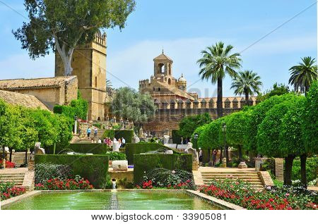 CORDOBA, SPAIN - MAY 16: Gardens of Alcazar de los Reyes Cristianos on May 16, 2012 in Cordoba, Spain. Alcazar has 55,000 square meters of gardens full of vegetation surrounded by fountains and ponds