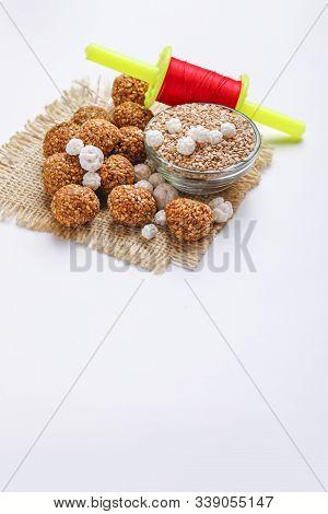 Til Gul Or Sweet Sesame Laddu With Fikri For Indian Festival Makar Sankranti Over White Background
