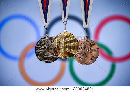 Tokyo, Japan, June. 20. 2019: Silhouette Of Medal Trophy, Olympic Circles In Background. Background