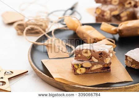 A Variety Of Different Nutty Nougat In Dark Chocolate With Roasted Hazelnuts Cut Open To Show The No