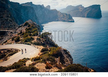 Couple Of Cyclist On The Road In Cap De Formentor. Mallorca, Spain