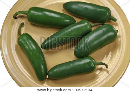 Jalepenos On A Yellow Plate