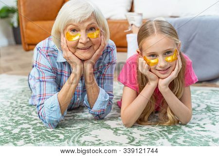 Girl And Her Grandmother Wearing Collagen Eye Pads